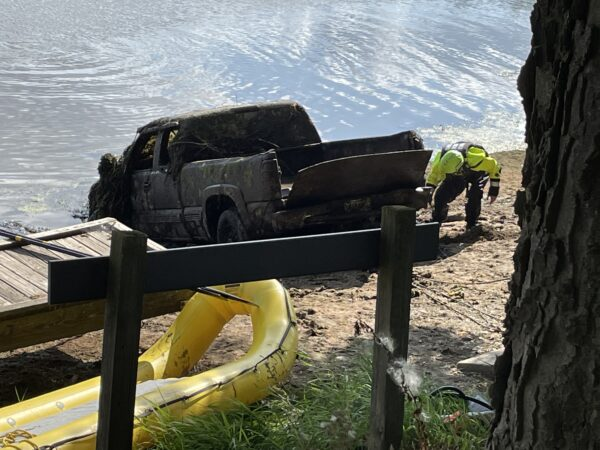 Truck that was revealed under the surface of the dam pond